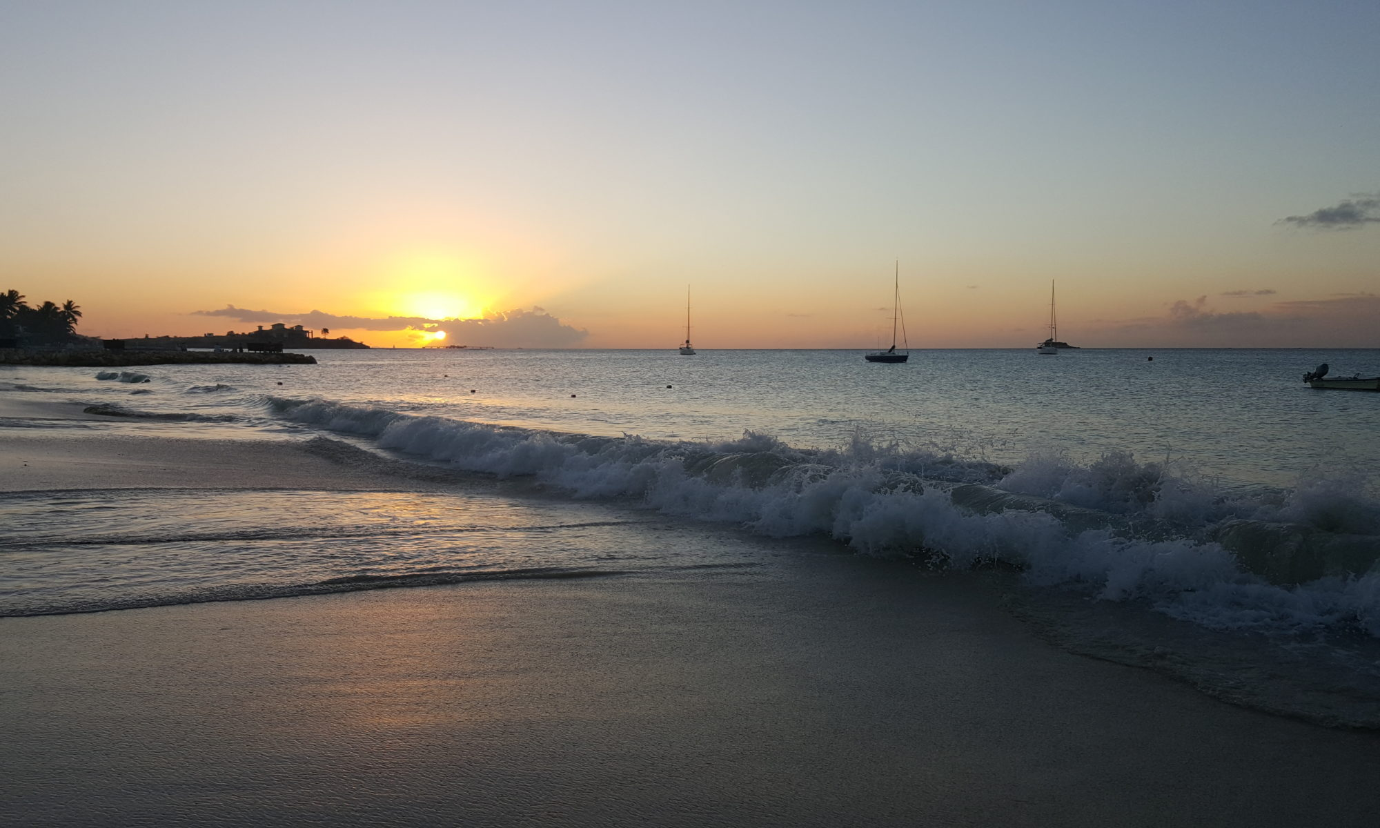 sunset caribbean beach sailing
